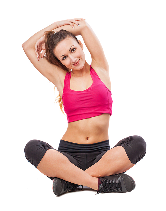 young pretty sporty girl stretching to do sport